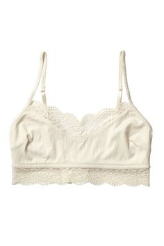 Tank-bra beauty that is as easy to pull on as it is pull off! All on soft in silky ribbing and scallop lace banding with adjustable straps. colour: wondrous white