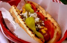 Noble Pig: Chicago-Style Hot Dogs  topped with tomatoes, sport peppers, white onion, sweet pickle relish, yellow mustard, celery salt....must get all beef hotdogs and poppyseed buns.