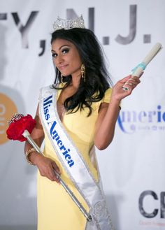 Miss America 2014 Nina Davuluri receives her winning scholarship at the post-crowning press conference.