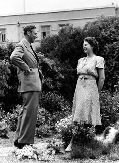 FILE - In this Aug. 20, 1946 file photo, Britain's Queen Elizabeth II, then Princess Elizabeth, right, enjoys a joke with her father King George VI, in the g...