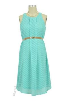 This sleeveless dress in a print of chevron has pretty soft pleating. It was designed to complement the feminine figure in a contemporary chic manner. The pleats serve a secondary purpose to hide a vertical center zipper, so you can wear it just as you would to nurse.  Keyhole slit back adds to the allure. Includes tan elastic leather front belt.  Fully lined....