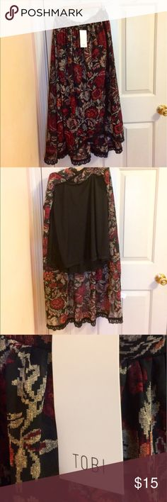 Beautiful NWT Tobi skirt! Beautiful fabric and great cut. Size small but has elastic waistband in back so S/M I'd say. Great lace detailing on a front slit skirt. Slight high to low. Attached shorter black slip. NWT. Tobi Skirts A-Line or Full