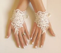 Elegant ivory lace and silver cord bridal gloves adorned pearls Wanting to feel yourself unique for you Each custom-made suitable Products 24 Bridal Cuff, Bridal Lace, Bridal Jewelry, Ivory Wedding, Wedding Wear, Lace Gloves, Fingerless Gloves, Lace Cuffs, Wedding Gloves