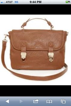 17a7a4893 Supple vegan leather bag has two gold front snaps designed to look like  cute buckles!