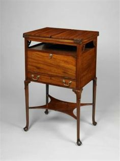 A rare George II mahogany dressing table and wash stand. The upper section with an envelope top opening to reveal a leather inset writing surface, above small circular and square wells for porcelain or glass receivers. The back with a recessed sliding mirror within a moulded cushion frame above a door in the frieze and a drawer below. Supported on circular tapering legs, the knees with tongue overlay, separated by a concave stretcher with indented circular dish, possible for a porcelain bowl. Georgian Furniture, Antique Furniture, Filing Cabinets, Wash Stand, Night Stand, Concave, Dressing Table, Wells, Art Decor