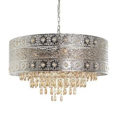 Lighting is an artful endeavor, especially in the case of our bejeweled chandelier. Influenced by modern bohemian styling, our gleaming, metallic chandelier features a punched floral pattern and warm amber crystal beads and drops. Chandeliers, Diy Chandelier, Chandelier Bedroom, Amber Crystal, Crystal Beads, Crystals, Crystal Lights, Modern Bohemian, Bohemian Decor