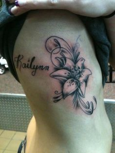 rib tattoo with daughters name