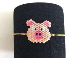 Items similar to Evil Eye Bracelet, Miyuki Mini Bracelet, Evil Eye Beadwork, Beaded Bracelet, Brick Stitch Bracelet on Etsy Beaded Earrings Native, Beaded Brooch, Diy Earrings, Peyote Patterns, Beading Patterns, Stitch Patterns, Beaded Crafts, Peyote Beading, Beaded Animals