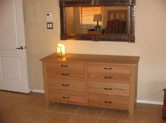Craftsman style eight drawer Dresser. Built with red oak, this Dresser makes a beautiful addition to any bedroom. This simple yet elegant design will become a family heirloom.