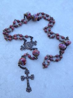 I handcraft heirloom quality gemstone rosaries in classical chain work. The rosary bead parts are vintage reproduction.