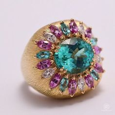 Summer Crush by @piaget - pink gold ring with Palace decor engraving, 1 oval-cut #Paraiba tourmaline from Mozambique (approx. 5.12 cts), marquise-cut pink sapphires and marquise-cut diamonds. #SunnySideofLife