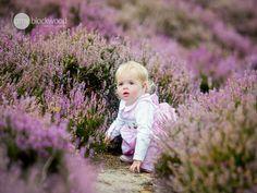Natural Child photography on location. Frensham. Surrey based photographer, Amy Blackwood Photography. Purple Heather.