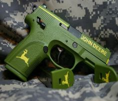 John Deere Themed pistol pits the Hill in Hillbilly! But the Gun isnt american made? Weapons Guns, Guns And Ammo, Custom Guns, John Deere Tractors, Lawn Tractors, Cool Guns, Awesome Guns, Self Defense, Tactical Gear