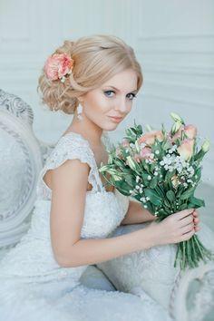 Gorgeous peach toned flowers to accent hairstyle and wedding dress.