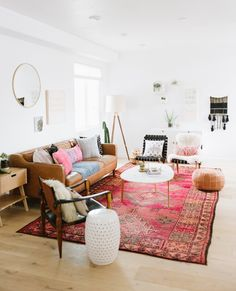 Pink oriental rug with tan leather sofa