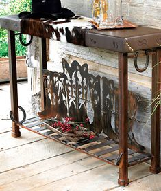 Boot Table with Cowhide and Horseshoe perfect for the entry table i've been lookin for!