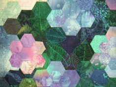 Several pictures of beautiful hexagon quilts
