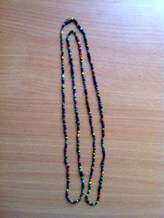 Colorful, handmade beaded necklace. 100% of sales go to support the Youth Education Network of Kenya - www.yenkenya.org