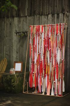 photo backdrop rag curtain in red coral peach and lace. photography by Justin Wright