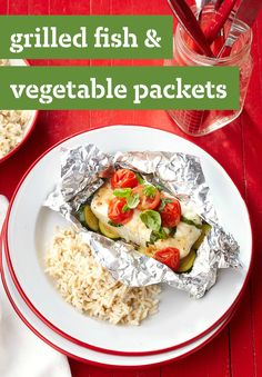 Grilled Fish & Vegetable Packets -- Ready for the dinner table in just 30 minutes, you can already imagine opening this foil packet hot off the grill, filled with halibut, zucchini, tomatoes and fresh basil leaves.