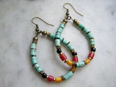 Love these turquoise hoop earrings.  I filled the turquoise hoops with dots of 3mm red coral, bright yellow mother of pearl, black onyx and antiqued