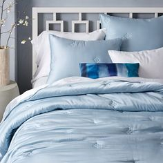Looking for blue bedding inspiration? Look no further! With its super smooth texture and silky softness, our Washed Silk Quilt + Shams bring lived-in luster to your bed. Subtle patterns are stitched in for some textural contrast