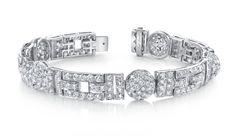 Rihanna reveals a stunning Neil Lane platinum and diamond bracelet at the amfAR gala!