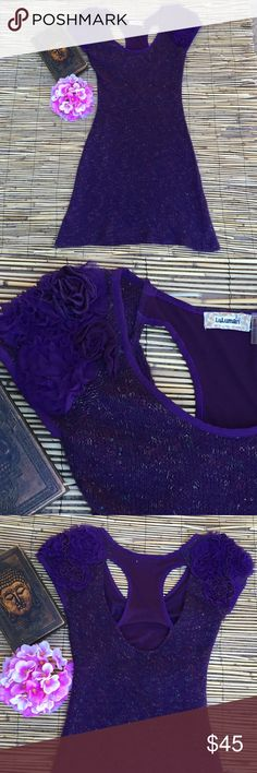 """Amazing sweater dress! So cute and unique! Purple sweater dress with beautiful rosette detail on the sleeves and racer back. Measures approximately 15"""" underarm to underarm and 35"""" from shoulder to hem. Acrylic/polyester blend with nylon lining. Luluman Dresses"""