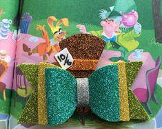 Items similar to Mad Man Tea Party Bow on Etsy Pinterest Design, Diy Leather Bows, Disney Hair Bows, Glitter Crafts, Handmade Hair Bows, Felt Bows, Boutique Hair Bows, Disney Crafts, Disney Diy