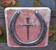 Hey, I found this really awesome Etsy listing at http://www.etsy.com/listing/103611178/horseshoe-nail-cross-wall-hanging-rustic
