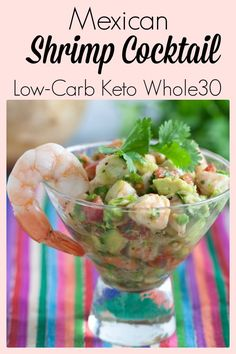 """This Mexican shrimp cocktail, also known as """"Ceviche"""" is a delicious appetizer, or light meal. Made with simple, real food ingredients of shrimp, avocado, tomato, and fresh herbs, this easy appetizer is low-carb, Keto friendly and Paleo and Whole30 compliant as well. Serve it in a glass or ceramic bowl, or dress it up in a Martini grass with your favorite chips on the side. 