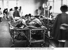Injured people waiting for treatment after a riot in Soweto outside Johannesburg South Africa The rioting started after police opened fire on a march. Black History Books, Lest We Forget, Continents, The Outsiders, Police, Waiting, People, South Africa, Folk