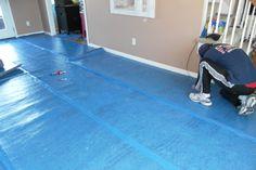 installing a moisture barrier for laminate flooring… Hardwood Floor Colors, Light Hardwood Floors, Laminate Flooring Diy, Wood Flooring, Basement Remodeling, Basement Ideas, Mobile Living, Remodeling Mobile Homes, Home Upgrades