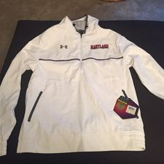 NWT under Armour Maryland cold gear jacket NWT hooded pullover jacket with side zips.  Mens medium Under Armour Jackets & Coats