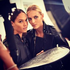 Supermodels Joan Smalls and Anja Rubik in action, backstage at yesterday's Gucci #SS15 show. #MFW