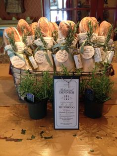 basket with French bread loaves tied with mini olive oil bottles and rosemary sprigs