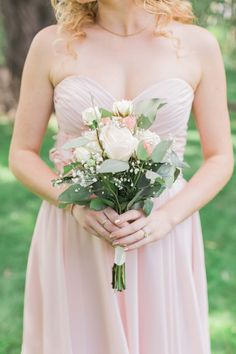 Romantic, simple, bridesmaid bouquet with white and blush roses http://www.confettidaydreams.com/dreamy-summer-garden-wedding-with-romantic-rustic-barn-details/