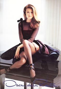 love the gorgeous bows & sheer sleeves & neckline detailing on this amazing dress on Italo-French songwriter, singer, actress, former model, & wife of the French President, Carla Bruni