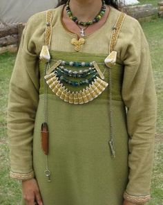 "Interesting apron dress pieced together of two different fabrics of similar color,  by ~DarkSunTattoo - Viking ""lady gear"".  Note the jewelry style characteristic of Gotland."