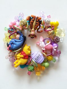 This super cute bracelet is perfect for the Disney fan! The button beads are Winnie the Pooh, piglet, Tigger and Eeyore. This lightweight and comfortable bracelet measures 7 in on stretch cording. Disney Jewelry, Eeyore, Cute Bracelets, Winnie The Pooh, Super Cute, Beads, Gifts, Etsy, Beading