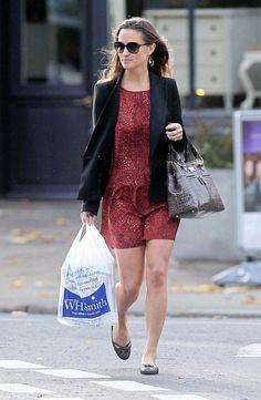 Pippa Middleton strolled to work in a flirty red ditsy print dress layered under her trusty black boyfriend blazer.