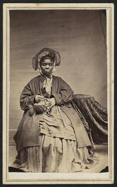 "Woman with a basket. Library of Congress Gladstone Collection. Photos says ""Charlotte Scott"" on the back."