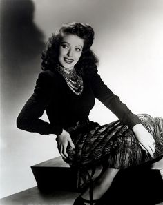 The immensely pretty Loretta Young sporting an elegant daywear look, complete with oodles of stylish necklaces.