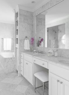 Beautiful marble master bathroom with white bathroom cabinets, Walker Zanger's Statuarietto marble counter top, double sinks, Venatino marble tiles and backsplash and brushed nickel vanity stool ottoman. Master Bathroom Vanity, White Bathroom Cabinets, Bathroom Renos, Small Bathroom, Bathroom Ideas, Modern Bathroom, Marble Bathrooms, Vanity Sink, Bad Inspiration