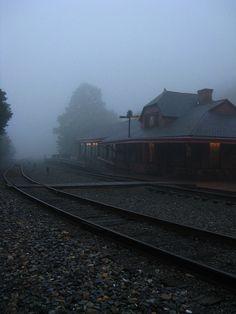 imagine the headlight of a train approaching through the fog...
