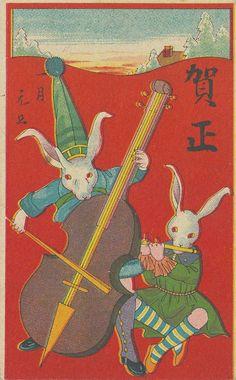 Rabbits playing musical instruments, 1927. Japanese New Year card.