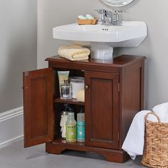 Wooden weatherby bathroom pedestal sink storing bathroom cleaning supplies, toilet paper, and other toiletries Pedestal Sink Storage, Bathroom Sink Storage, Bathroom Vanities, Pedistal Sink, Bathroom Basin, Bathroom Wall, Storage Hacks, Diy Storage, Storage Ideas