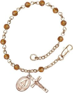 14kt Gold Filled Rosary Bracelet features 4mm Topaz Swarovski beads. The Crucifix measures 1/2 x 1/4. Each Rosary Bracelet is presented in a deluxe velvet gift