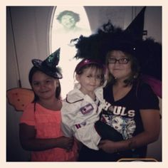 Left to right; Mackenzie, Amy & Ariaunna ready to trick or treat. Do you see the ghost?