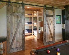 The barn doors create a division between rooms and add to the rustic feel of the home.